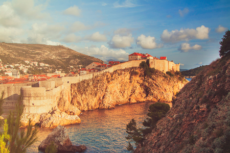 dalmatia: Panorama of the city of Dubrovnik, old defense walls, fortress Bokar, warm filter applied