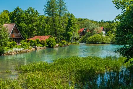 vibrant cottage: Beautiful village of Rastoke near Slunj in Croatia, river Slunjcica, old water mills and cottages Stock Photo