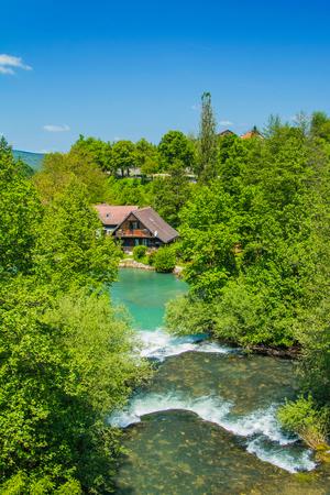 vibrant cottage: Beautiful village of Rastoke near Slunj in Croatia, river Slunjcica, old water mills on waterfalls Stock Photo