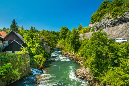 vibrant cottage: Canyon of Korana river and beautiful village of Rastoke near Slunj in Croatia, old water mills on waterfalls