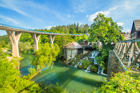Bridge over Korana river canyon and beautiful village of Rastoke near Slunj in Croatia, old water mills on waterfalls, beautiful countryside landscape Stock fotó
