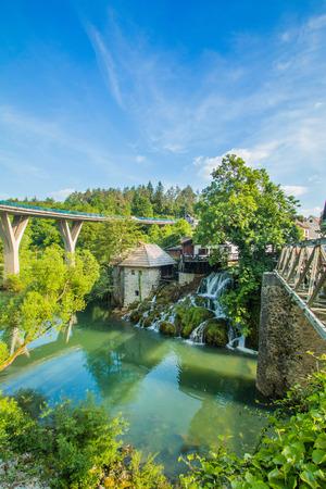 vibrant cottage: Bridge over Korana river canyon and beautiful village of Rastoke near Slunj in Croatia, old water mills on waterfalls, beautiful countryside landscape Stock Photo