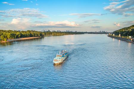 dnepr: Tourist boat on the Dnepr River in Kiev, Ukraine, bridges and city skyline in background