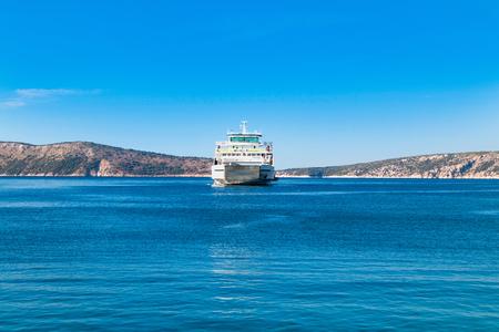 krk: Passenger ferry boat between islands of Cres and Krk on Adriatic sea in Croatia