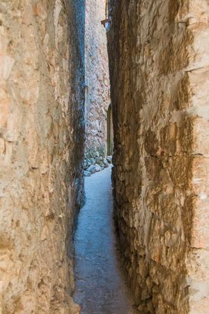 krk: Narrowest street in the world in old town Vrbnik on the island of Krk, Croatia, Mediterranean ambient Stock Photo