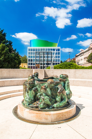 of Life, sculpture made by Croatian sculptor Ivan Mestrovic with the new modern building of Croatian Music Academy in background