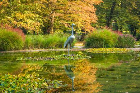 bather: The crane bird statue in beautiful public park in Daruvar, Croatia, in autumn