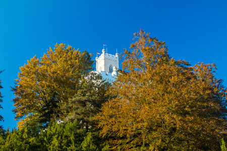 architecture monumental: Roof of the Castle of Trakoscan above trees on hill in autumn, Zagorje, Croatia