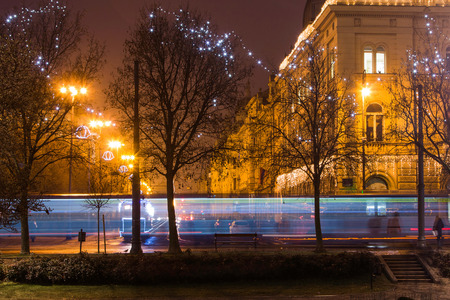 Tram passing King Tomislav Square in Zagreb Croatia during Advent, blue light trail