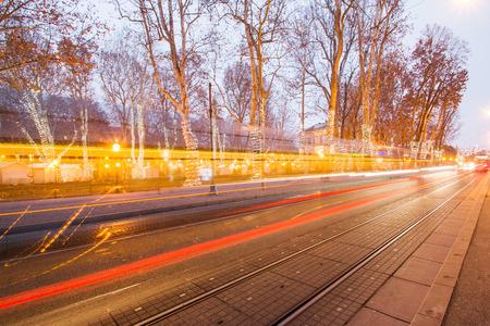 Tram passing Zrinjevac park in Zagreb Croatia during Advent, blue light trail, motion blur