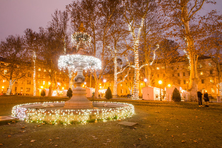 Illuminated fountain in Zrinjevac park, Zagreb, Croatia, Christmas market, Advent