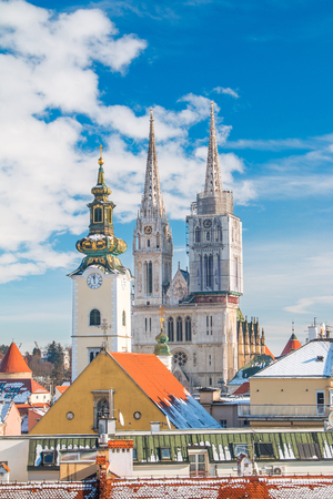 architecture monumental: Panoramic view of cathedral in Zagreb, Croatia, from Upper town, winter, snow on roofs Stock Photo