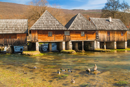 Old wooden water mills in on Majerovo vrilo, source of Gacka river, Lika, Croatia