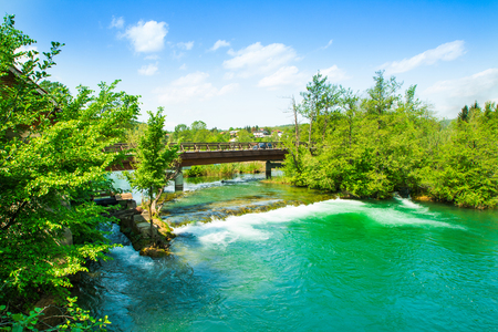 Panoramic view on waterfall and wooden bridge on Mreznica river in Belavici, Croatia 免版税图像