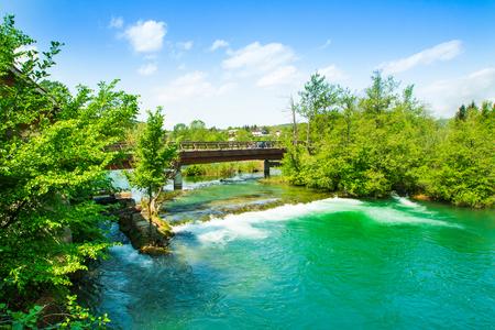 Panoramic view on waterfall and wooden bridge on Mreznica river in Belavici, Croatia 版權商用圖片 - 101577111