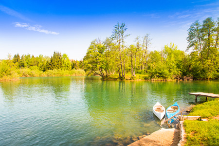 Beautiful countryside landscape and canoes in village of Belavici on Mreznica river in Croatia 版權商用圖片