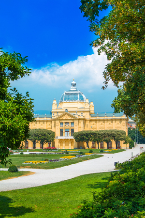 Zagreb, Croatia, art pavilion and trees in beautiful summer day, colorful 19 century architecture Редакционное