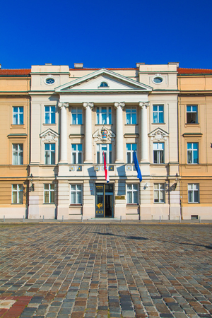Palace building of Croatian Sabor parliament with flags of Craotia and European Union in Zagreb Croatia