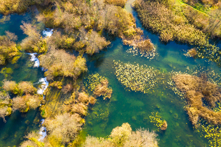 Croatian river Mreznica from air, drone shoot, top down view, Karlovac county, green nature, bayous, wood and waterfalls in autumn