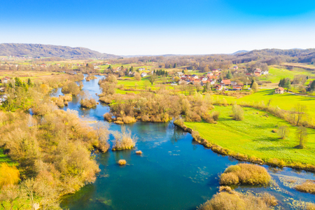 Croatian countryside landscape, Mreznica river from air, panoramic view of Belavici village and waterfalls in autumn Фото со стока - 114901448