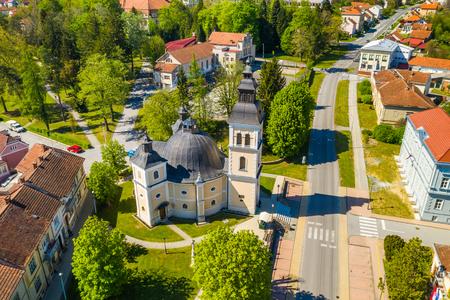 Croatia, Slavonia, town of Daruvar, catholic church in spring, panoramic drone view