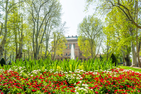Zagreb, Croatia, park Zrinjevac and academy of science and arts palace in background, beautiful spring day, popular tourist destination Редакционное