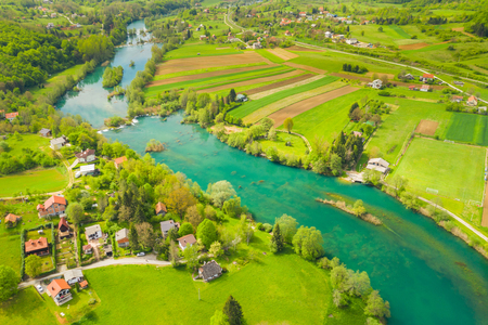 Croatian countryside landscape, beautiful green Mreznica river from air, panoramic view of Belavici village and waterfalls in spring, popular tourist destination
