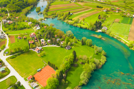 Croatia nature, beautiful green Mreznica river from air, panoramic view of Belavici village and waterfalls in spring, popular tourist destination
