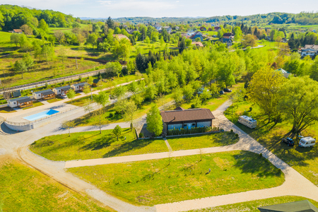 Croatia, green countryside, Mreznica river from air, panoramic view of Belavici village, waterfalls in spring, popular tourist camping resort destination