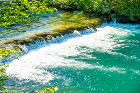 Beautiful waterfall on Mreznica river in Belavici, Croatia, green countryside landscape in Karlovac region