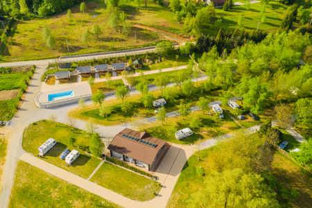 Aerial view of camping resort on Mreznica river in Croatia, beautiful nature coutryside landscape