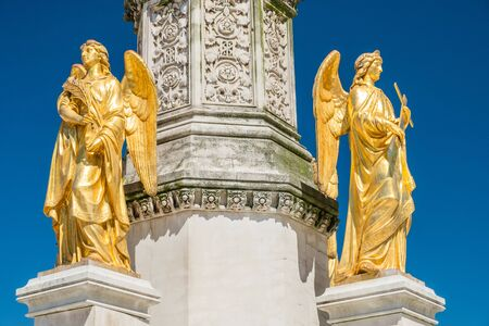 Mary column with golden angels statues in front of cathedral in Zagreb, Croatia, blue sky 免版税图像