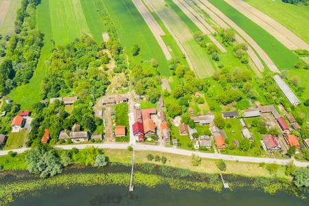 Rural Croatia, beautiful countryside landscape in nature park Lonjsko polje from air, panoramic view of traditional village Muzilovcica 免版税图像