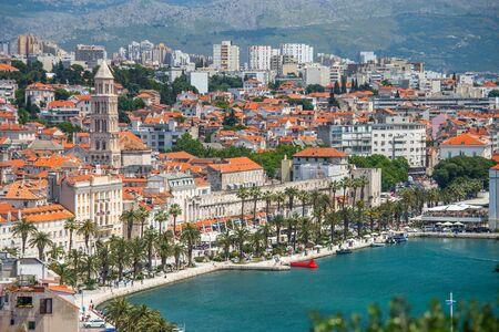 Old town of Split in Dalmatia, Croatia. Panoramic view of city center, palace of Roman emperor Diocletianus and cathedral. Popular tourist destination in Europe.