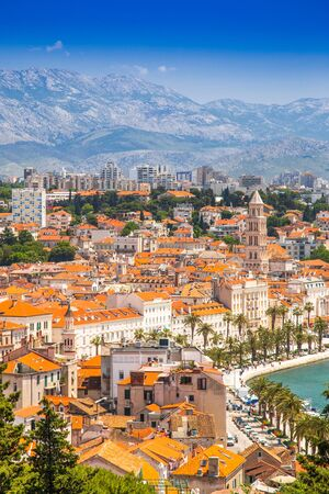 Old town of Split in Dalmatia, Croatia. Panoramic view of city center, palace of Roman emperor Diocletianus and cathedral. Popular tourist destination in Europe. Stock Photo