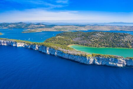 Aerial view of the Salt lake in nature park Telascica, Croatia, Dugi otok, big stone cliffs above the sea