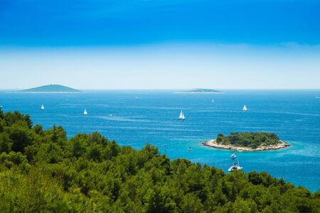 Panoramic view on Kosirina lagoon on Murter island in Croatia, sailing boats and yachts on blue seascape