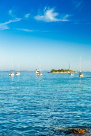 Yachting on Adriatic sea in Croatia, sailing boats and yachts in the morning in blue bay lagoon on Murter island Reklamní fotografie