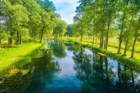 Beautiful river Gacka, drone aerial over the river surface between the trees, Lika region of Croatia
