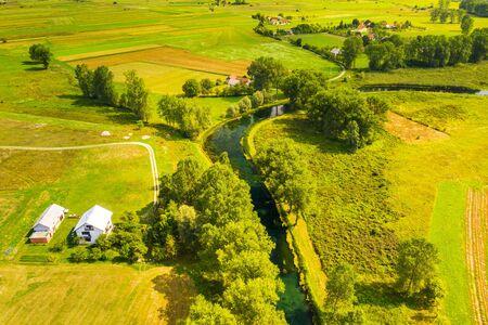 Croatia, countryside landscape, small village by Gacka river in region of Lika, aerial view Reklamní fotografie