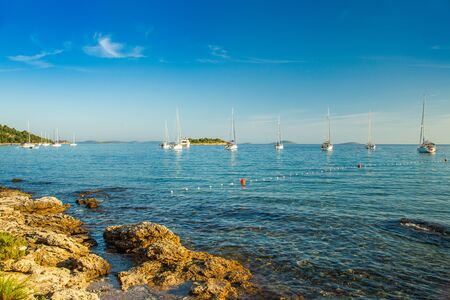 Beautiful Adriatic sea in Croatia, sailing boats and yachts in the morning in blue bay lagoon on Murter island Reklamní fotografie