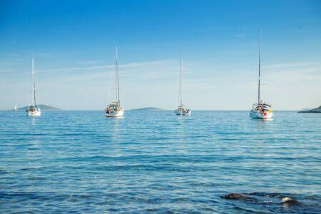 Beautiful Adriatic sea in Croatia, sailing boats and yachts in the morning in blue bay lagoon on Murter island