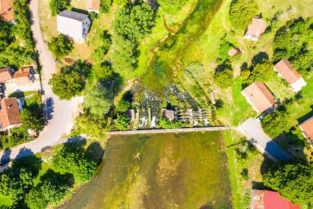 Tonkovic vrilo, river source of Gacka and wooden bridge over the river, aerial view, Lika region of Croatia