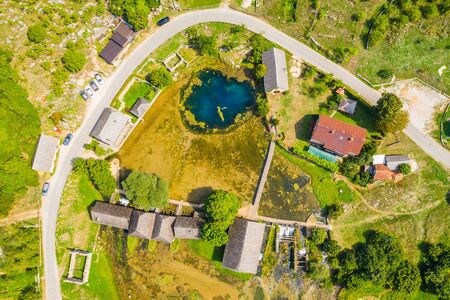 Majerovo vrilo river source of Gacka aerial drone view, Lika region countryside of Croatia, old wooden mills and cottages