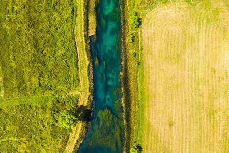Beautiful Gacka river, field aerial summer view, Lika region of Croatia