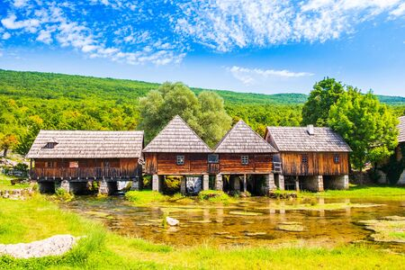 Croatia, region of Lika, Majerovo vrilo river source of Gacka, traditional village, old wooden mills and cottages