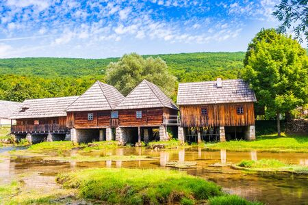 Croatia, countryside in region of Lika, Majerovo vrilo river source of Gacka, traditional village, old wooden mills and cottages
