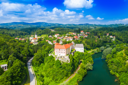 Panoramic view of the river Kupa and Ozalj Castle in the town of Ozalj, Croatia, drone aerial shot