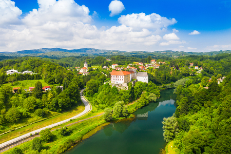 Aerial drone view of the river Kupa and Ozalj Castle in the town of Ozalj, Croatia