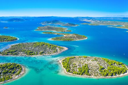 Croatian coast, beautiful small Mediterranean stone islands in Murter archipelago coastline, aerial view of turquoise bays with yachts and boats